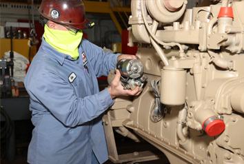 employee working on engine