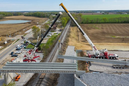 Cranes constructing a new vehicle overpass