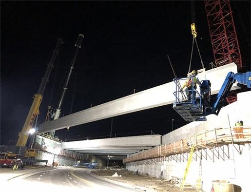 Series of night picks set Orlando bridge girders
