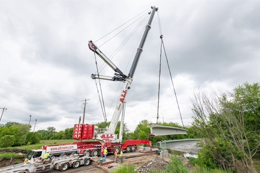 Liebherr LTM 1750-9.1 lifting a 117-foot precast bridge beam