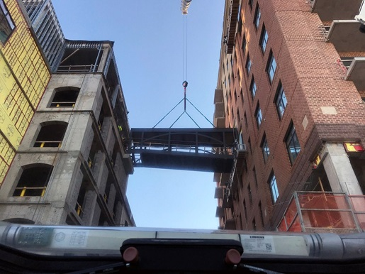 Team effort helps lift and set pedestrian bridge in Wilmington, North Carolina