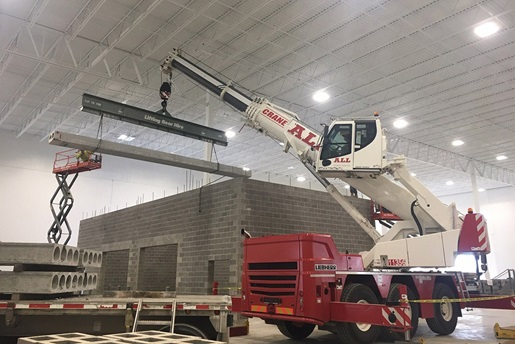 Liebherr LTC 1050-3.1 constructing a small precast building inside another building
